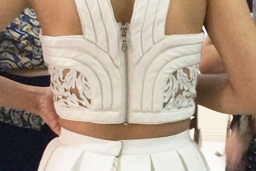 Back details of the contemporary grecian-inspired wedding gown.