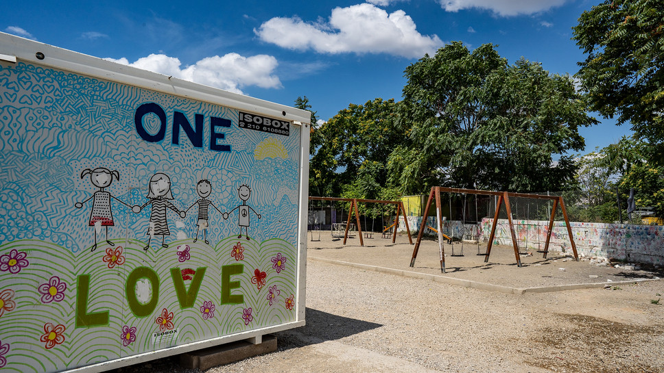 One love in the children's play area in Eleonas refugee camp