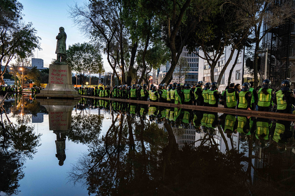 Police protect a monument in Mexico City