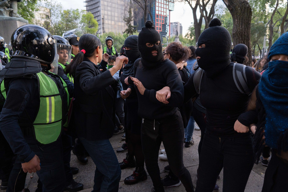 Activists join arms to keep the police back