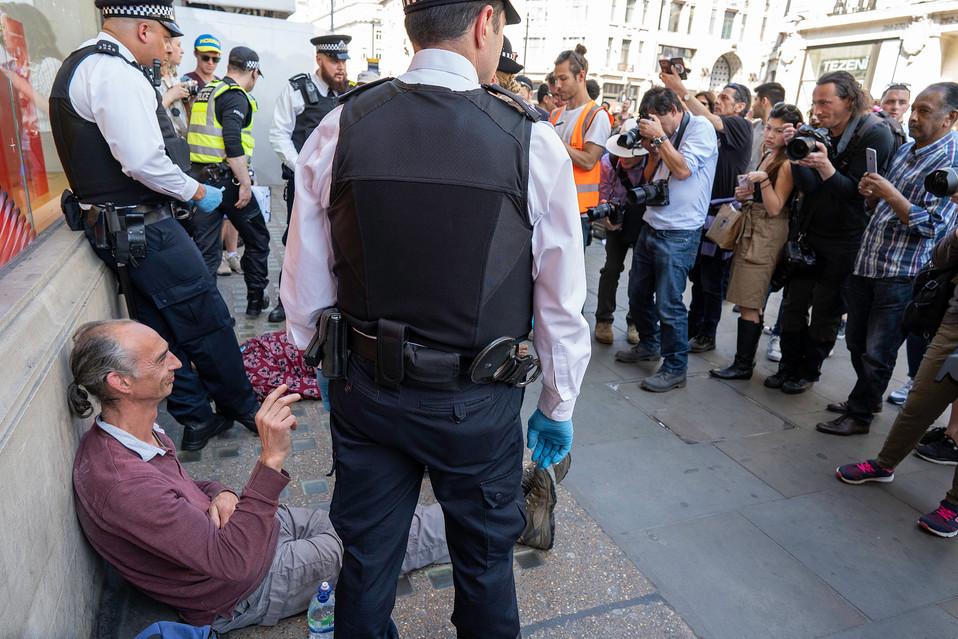 A protester smiles to the cameras
