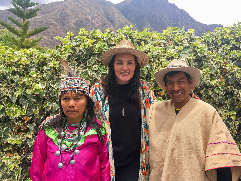 Shelley standing with shamans in Cusco