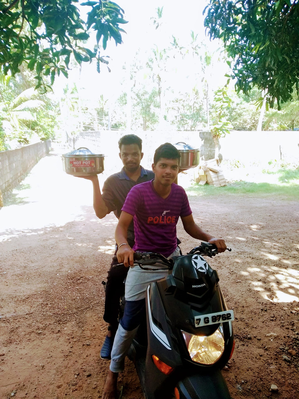 Indian men delivering food on a motorbike