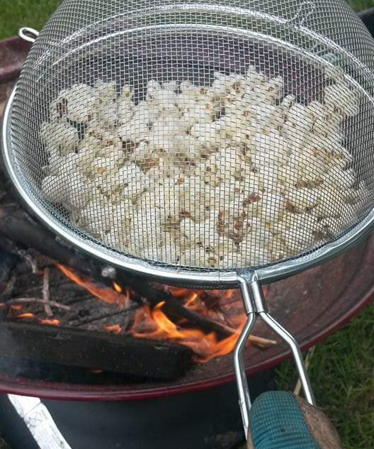 Cooking popcorn over the fire