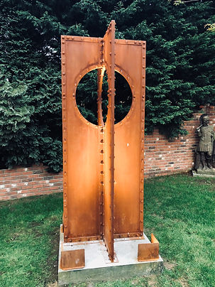rusty riveted cross garden sculpture