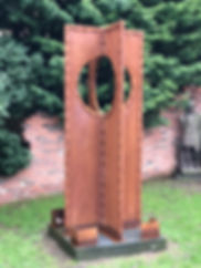 rusty riveted coss sculpture