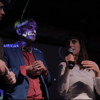 Moderator Don Undeen with cyborg duo Neil Harbisson and Moon Ribas
