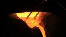 videoblocks-molten-metal-start-pouring-f
