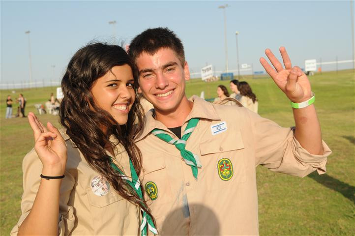 A young girl and boy in Israel Scout uniforms standing together
