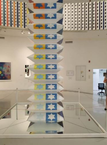 A tall sculpture featuring Stars of David displayed at the Yaacov Agam Museum