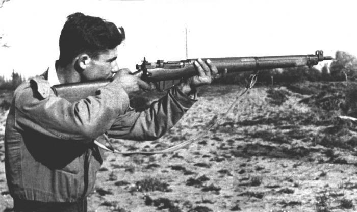 Haganah member, Shlomo Henig, practices shooting.