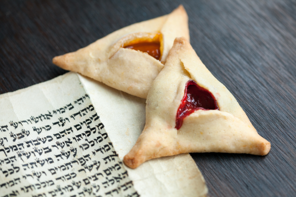 Two flavored hamantachen on top of the Book of Esther