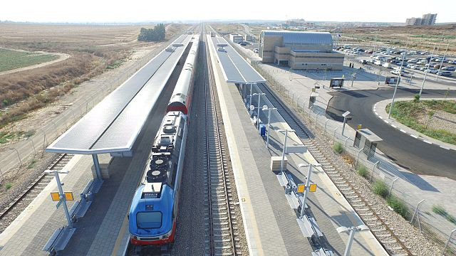 Aerial shot of the Netivot train station with a train stopped at the station