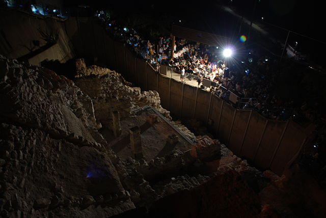 Aerial view of the City of David at night during a reading of Kinot