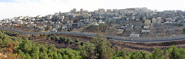 View of Shoaffat refugee camp near Jerusalem behind the Israeli security fence.
