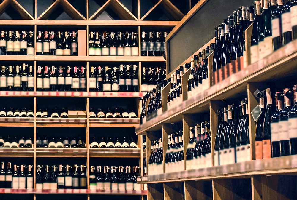 Shelves against two walls with rows and rows of Israeli wine bottles