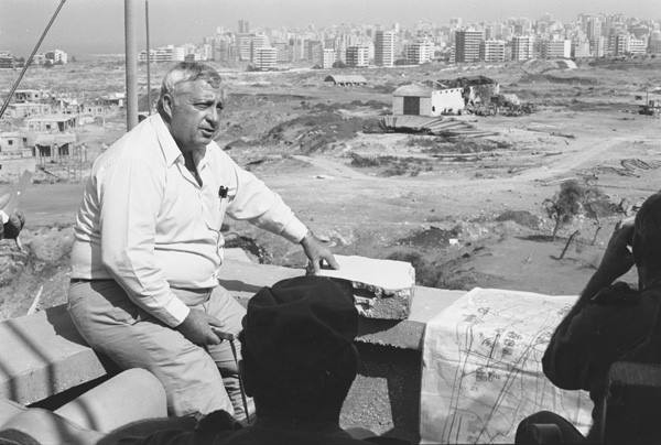 Ariel Sharon sitting on a Lebanese rooftop, overlooking the capital Beirut.