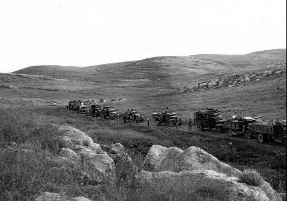 A line of vehicles traveling the Burma Road in 1948