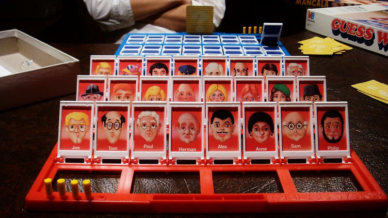 A Guess Who game board set up