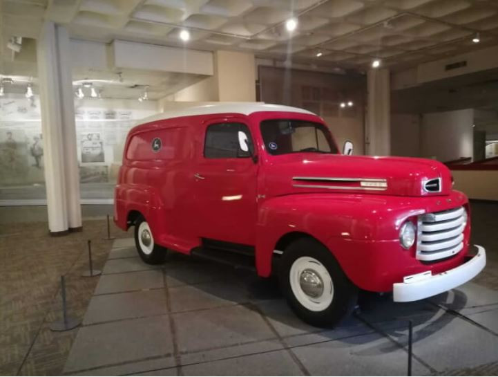 A bright red Israeli Post car inside the Eretz Yisroel Museum