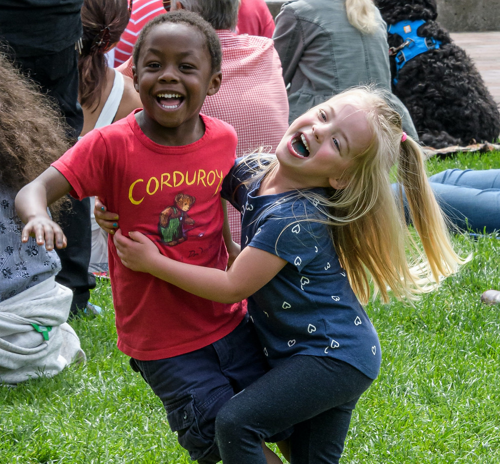 A young girl and young boy playing together