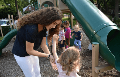 Tamar Segal playing with children during her gap year abroad