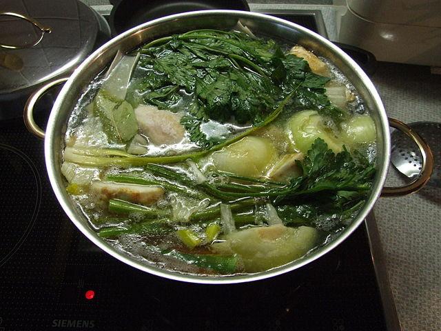 Pot of marak oaf (chicken soup)