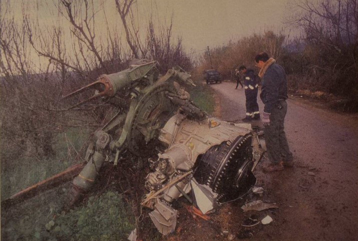 Remains of a helicopter crash on the side of a road in the bushes