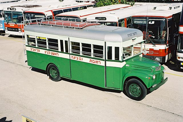 An old green and white Egged bus model from the 1940s