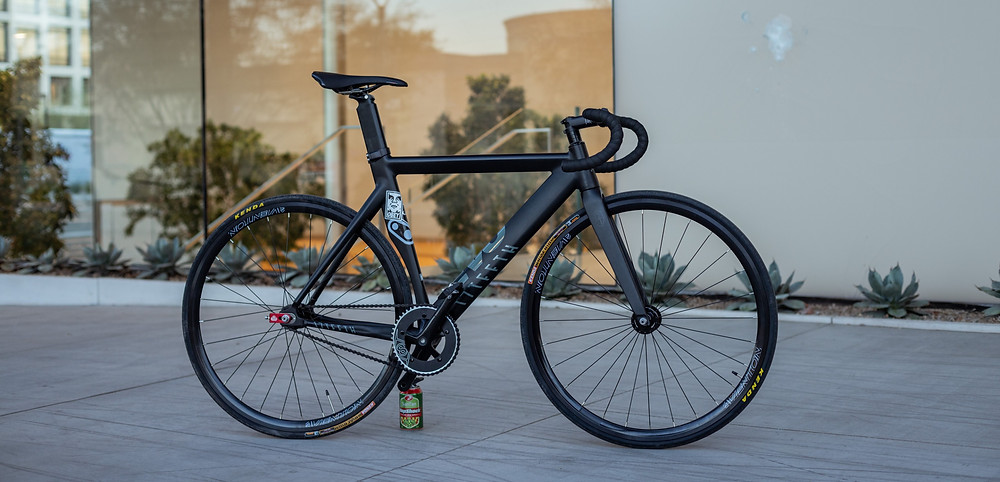A bicycle parked outside a shop in Tel Aviv