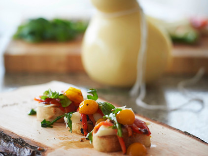 White Gold Caciocavallo Crostini with wilted Arugula and Cherry Tomatoes