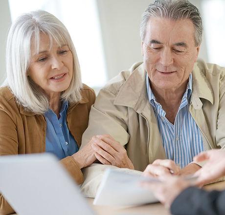 Senior couple meeting financial adviser for investment                _edited.jpg