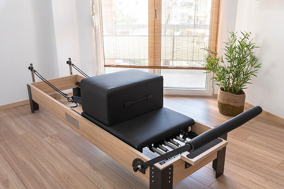 Pilates studio room with reformer beds.j