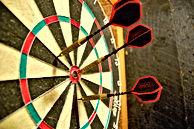 1200px-Darts_in_a_dartboard.jpg