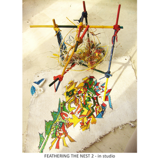 FEATHERING THE NEST 2 tree sculpture - in studio Medium:  string, wood, wire, cardboard, canvas, paint, feather