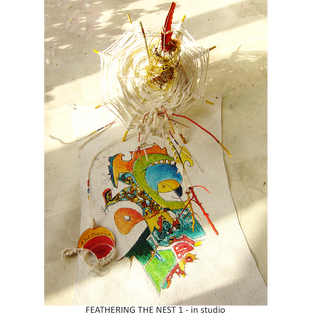 FEATHERING THE NEST 1 tree sculpture - in studio Medium:  wood, wire, string, cardboard, canvas, paint