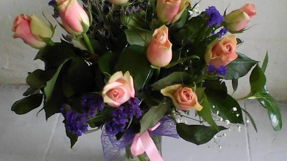 Pastel Roses in Glass Vase
