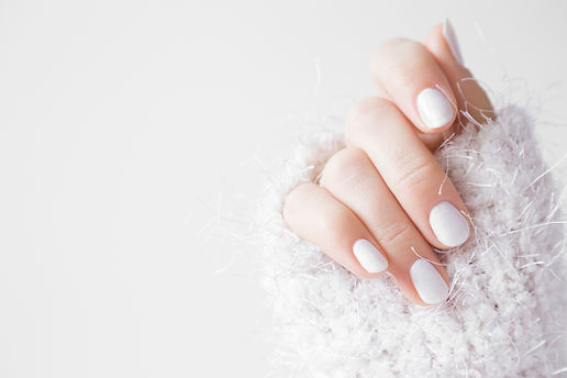 Beautiful groomed woman's hands with whi