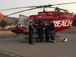 Flight Crew talks with Burney Medic Kim Golczynski and EMT Matt Walsh at the Burney LZ