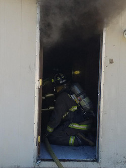 Firefighter Justin Shaw backing up the attack crew