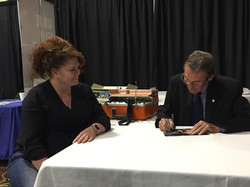 Theresa Laughlin getting a signed photo from actor Johnny Cage (Randolph Mantooth)