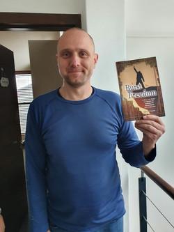 Warren with book