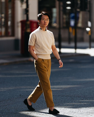 Buzz Tang wearing the cream The Anthology knitted t-shirt