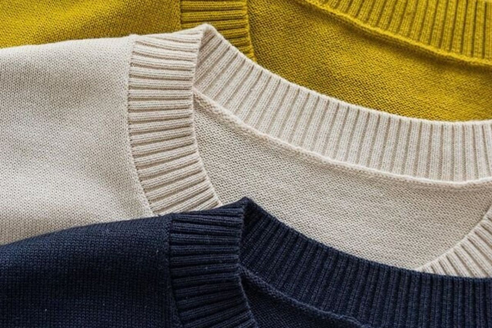 The Anthology's knitted t-shirt in cream, navy, and mustard