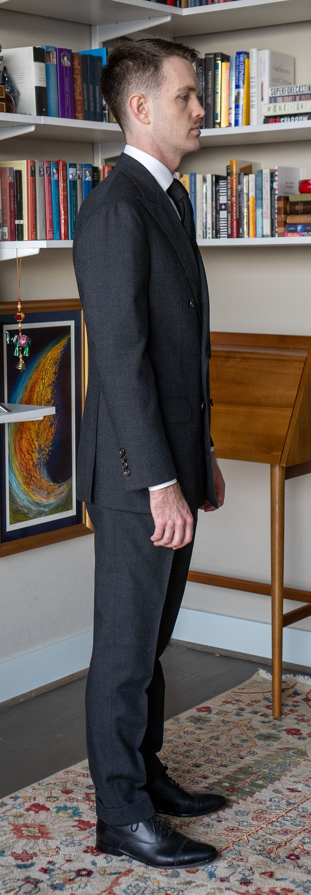 Full-length right side view of Anglo-Italian double-breasted suit