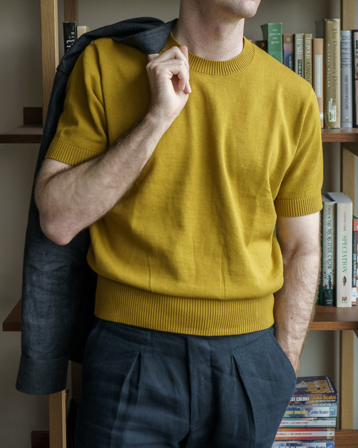 The Anthology mustard knitted t-shirt with Yeossal jungle jacket and Lopez Aragon trousers