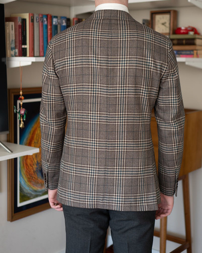 Back view of A Rake in Progress wearing the Cavour beige check jacket and Anglo-Italian trousers