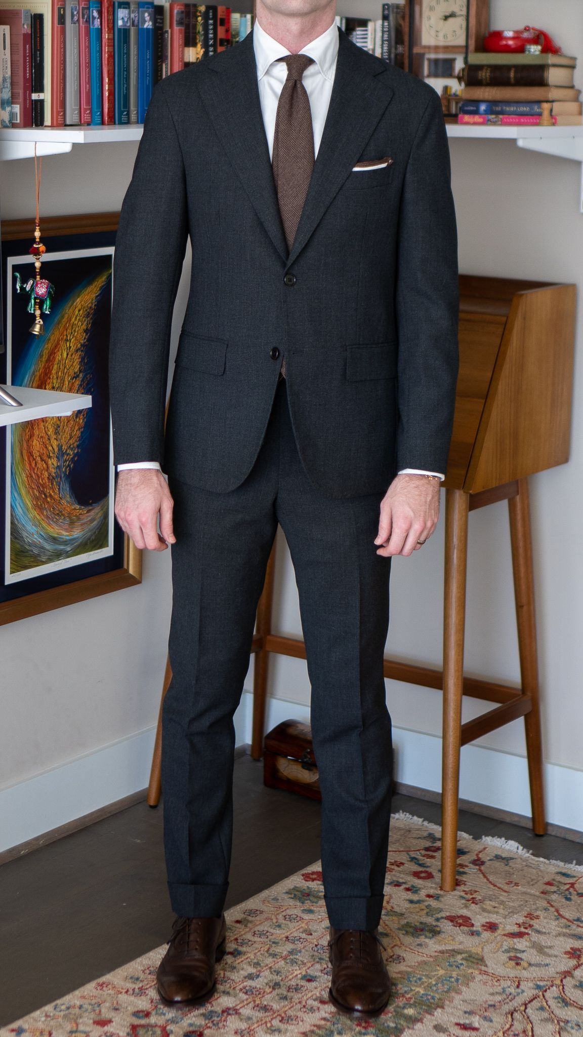 Full-length front view of A Rake in Progress wearing the Cavour gray winter hightwist suit