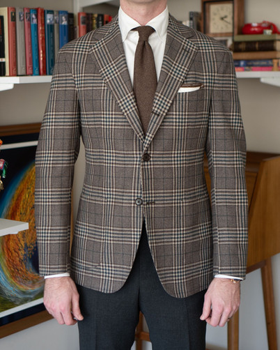 Front view of A Rake in Progress wearing the Cavour beige check jacket and Anglo-Italian trousers