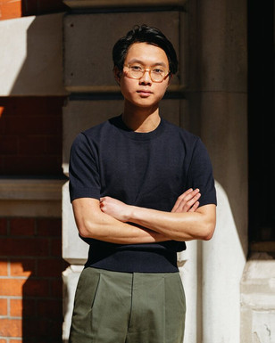 Buzz Tang wearing the navy The Anthology knitted t-shirt